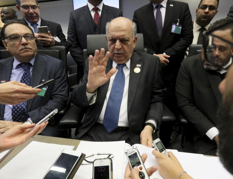 Iraq's Minister of Oil, Thamir Abbas Al Ghadhban speaks prior to the start of a meeting of the Organization of the Petroleum Exporting Countries, OPEC, at their headquarters in Vienna, Austria, Thursday, Dec. 6, 2018. (AP Photo/Ronald Zak)