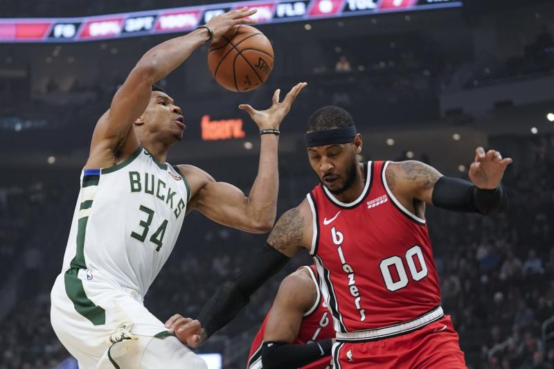 Giannis Antetokounmpo posted a career-high in assists with a triple-double against Portland. (AP Photo/Morry Gash)
