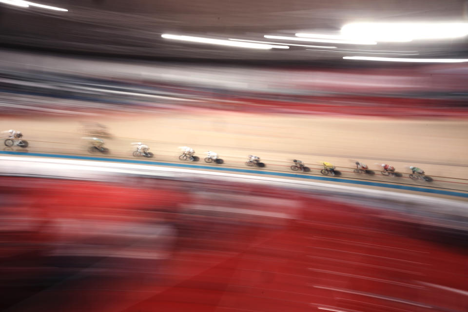 Athletes compete during the track cycling men's omnium tempo race at the 2020 Summer Olympics, Thursday, Aug. 5, 2021, in Izu, Japan. (AP Photo/Thibault Camus)