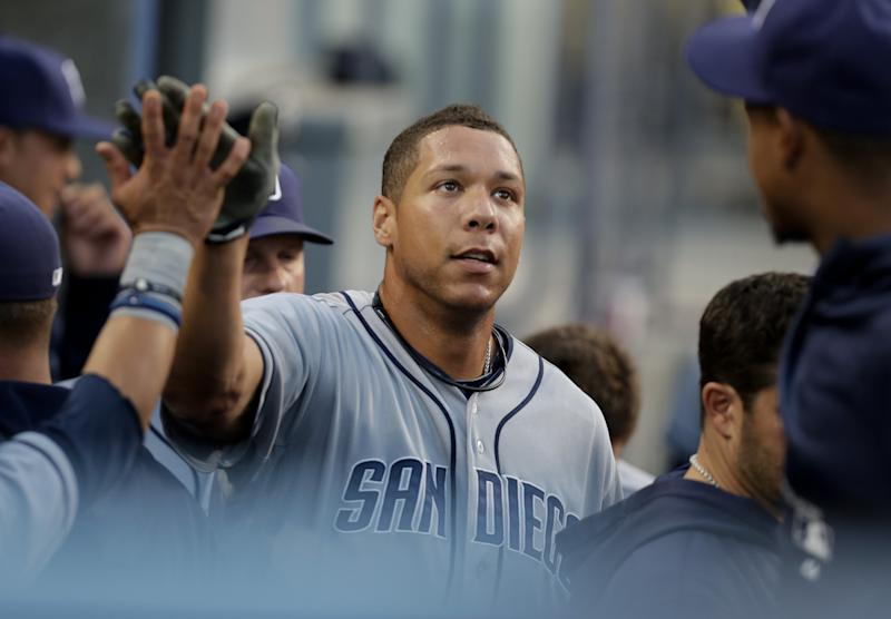 San Diego Padres' Kyle Blanks celebrates in the dugout after hitting a two-run home run in the second inning of their baseball game against the Los Angeles Dodgers, Tuesday, June 4, 2013, in Los Angeles. (AP Photo/Jason Redmond)
