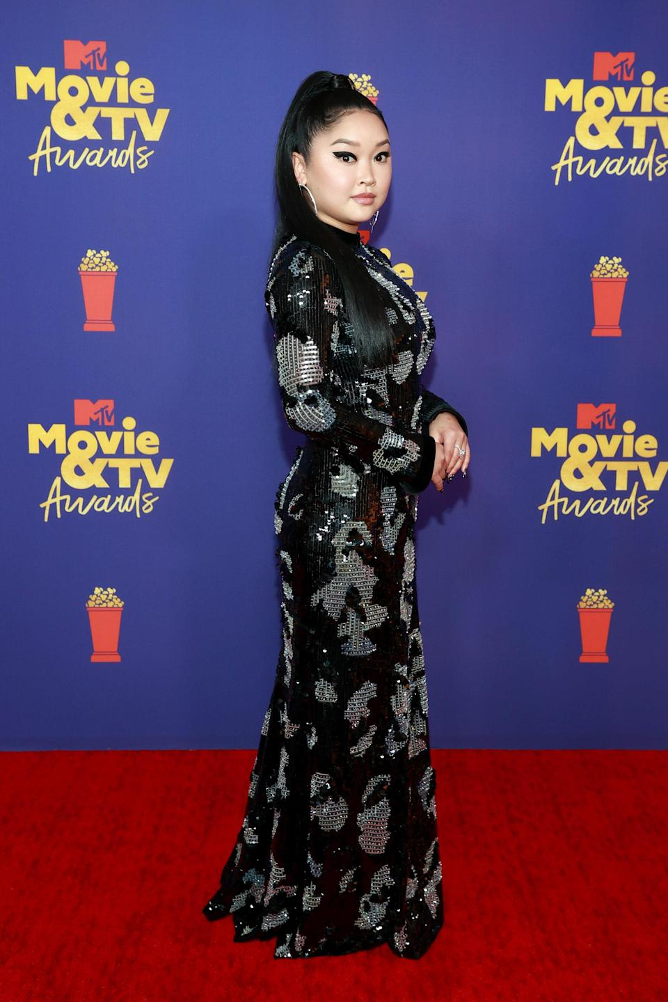 Lana Condor was the evening's lady <em>in noir</em>. Her killer winged liner and slick half-pony gave a sleek backdrop to her show-stopping Giorgio Armani gown. The all-black look glistened with three-dimensional sparkles and an abstract silver print. Styled by Tara Swennen, Lana's floor-length dress 'fit her perfectly with a high neck and cinched waist.
