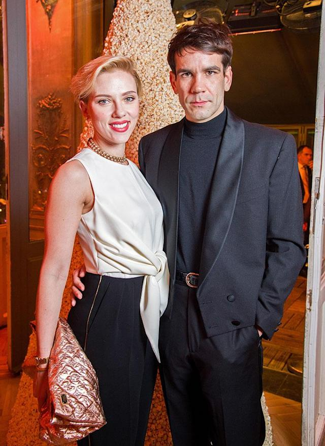 """<p><em>The Avengers </em>star and French journalist swiftly <a href=""""https://www.yahoo.com/entertainment/scarlett-johansson-finalizes-divorce-romain-195839292.html"""" data-ylk=""""slk:settled their divorce;outcm:mb_qualified_link;_E:mb_qualified_link"""" class=""""link rapid-noclick-resp"""">settled their divorce</a> after two years of marriage. """"We remain close friends and co-parents with a shared commitment to raising our daughter in a loving and compassionate environment,"""" they said in a <a href=""""https://www.yahoo.com/entertainment/scarlett-johansson-finalizes-divorce-romain-195839292.html"""" data-ylk=""""slk:joint statement;outcm:mb_qualified_link;_E:mb_qualified_link"""" class=""""link rapid-noclick-resp"""">joint statement</a>. Johansson has moved on with <em>Saturday Night Live</em> star Colin Jost. (Photo: Pascal Le Segretain/Getty Images for Yummy Pop) </p>"""