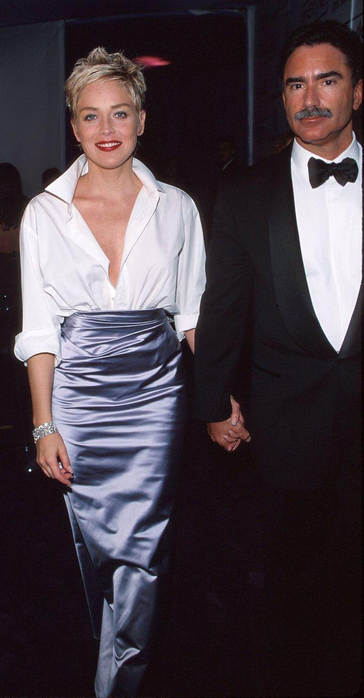 <p>Sharon Stone walked her own path at the '98 oscars when she pared a lavender satin Vera Wang skirt with a mens button down shirt. </p>