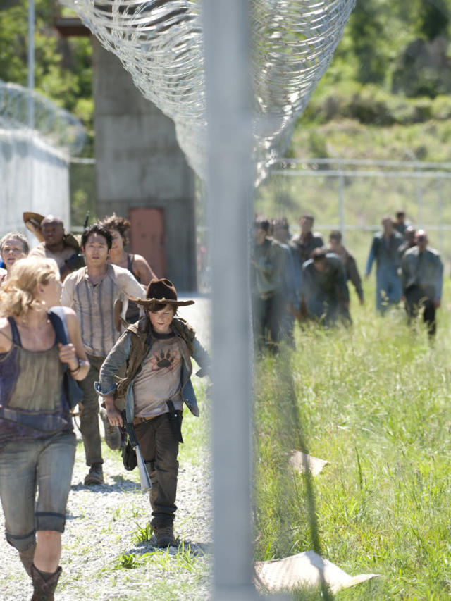 "Carol (Melissa Suzanne McBride), Beth Greene (Emily Kinney), T-Dog (Robert 'IronE' Singleton), Glenn (Steven Yeun), Maggie Greene (Lauren Cohan) and Carl Grimes (Chandler Riggs) in ""Seed,"" the Season Three premiere episode of ""The Walking Dead"" on AMC."