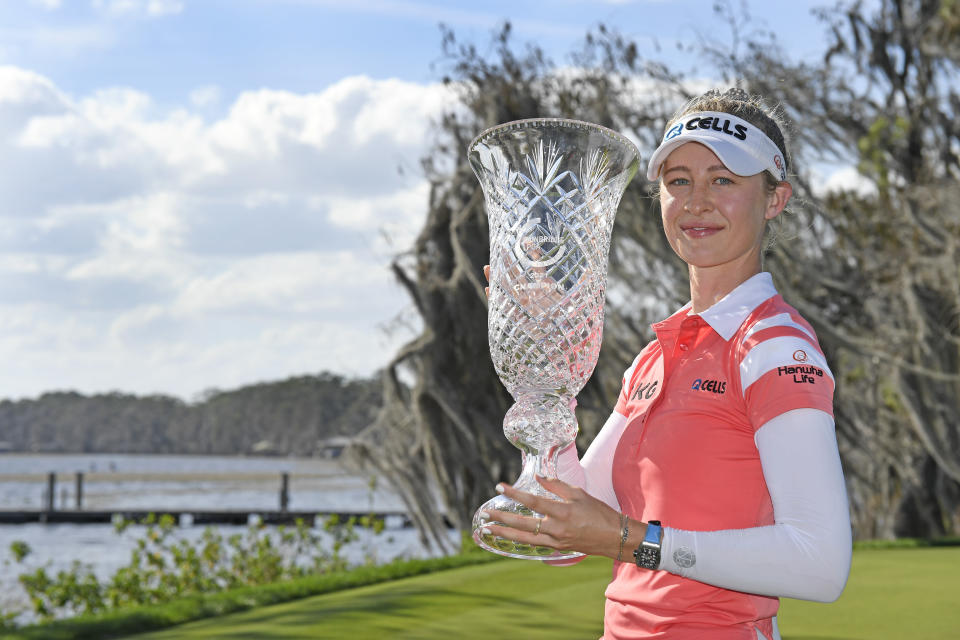 Nelly Korda celebrates with the winner's trophy after the final round of the Gainbridge LPGA golf tournament Sunday, Feb. 28, 2021, in Orlando, Fla. (AP Photo/Stan Badz)