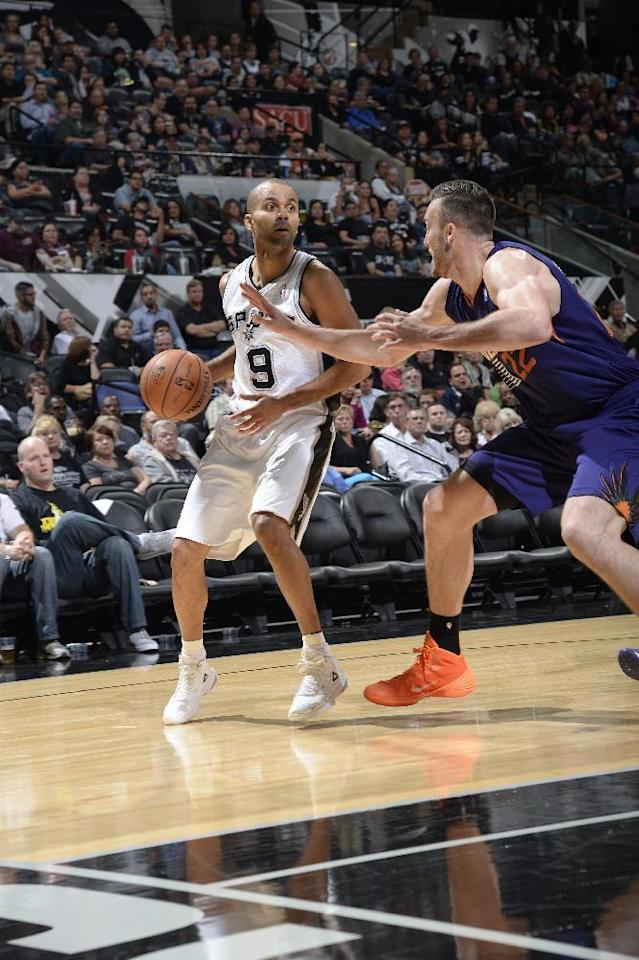 SAN ANTONIO, TX - November 6: Tony Parker #9 of the San Antonio Spurs controls the ball against Miles Plumlee #22 of the Phoenix Suns at the AT&T Center on November 6, 2013 in San Antonio, Texas