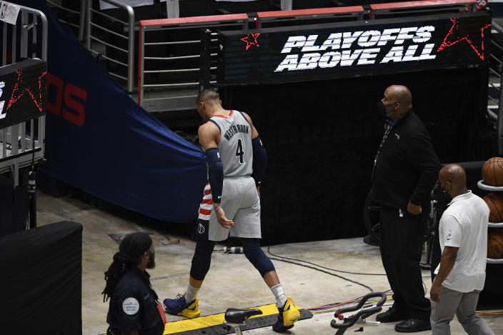 Washington Wizards guard Russell Westbrook (4) walks toward the tunnel during the second half of Game 3 in a first-round NBA basketball playoff series against the Philadelphia 76ers, Saturday, May 29, 2021, in Washington. (AP Photo/Nick Wass)