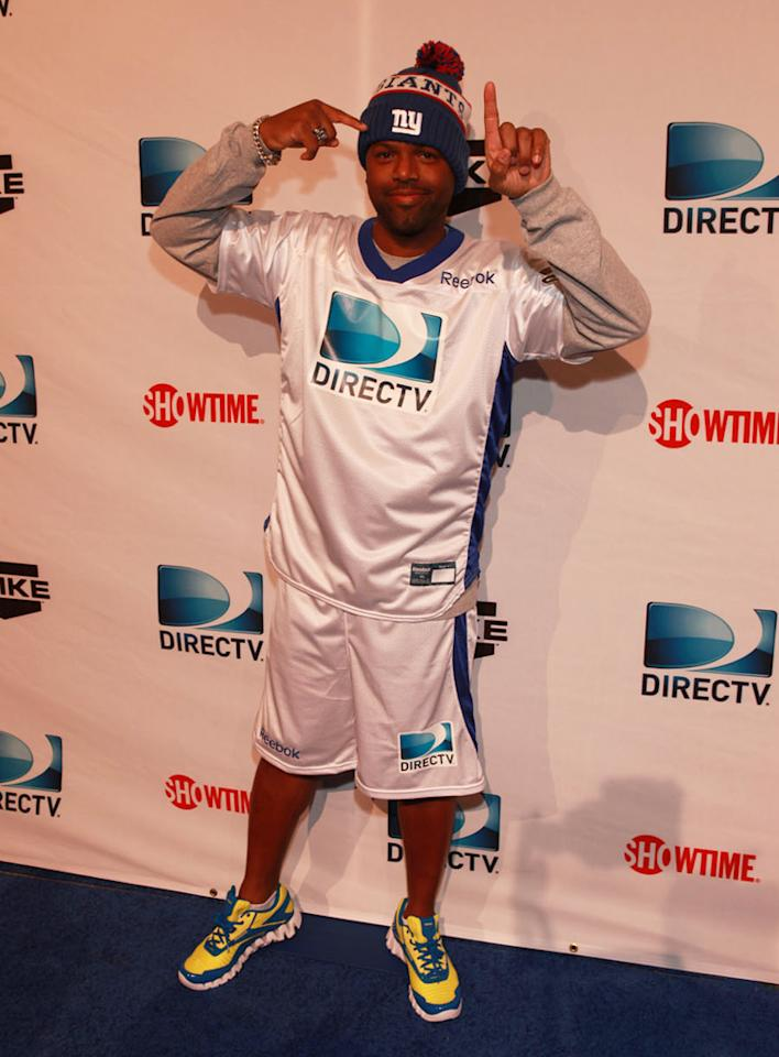 """Extra' TV correspondent AJ Calloway arrives at the DirecTV Celebrity Beach Bowl in Indianapolis."