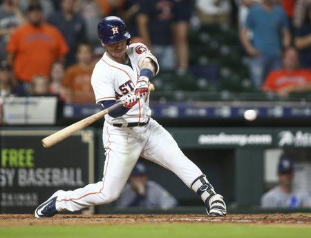 Jun 18, 2018; Houston, TX, USA; Houston Astros third baseman Alex Bregman (2) gets a game-winning RBI hit during the ninth inning against the Tampa Bay Rays at Minute Maid Park. Mandatory Credit: Troy Taormina-USA TODAY Sports