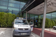 A police vehicle is parked in front of a hotel in Zenica, central Bosnia, Monday, April 20, 2020. Several dozen people in Bosnia are on a hunger strike to protest being quarantined in a hotel on suspicion they might be carrying the new coronavirus. The group of some 80 Bosnians work abroad and when they returned to the country they were placed under a 28-day quarantine in a hotel in the central town of Zenica. (AP Photo/Almir Alic)