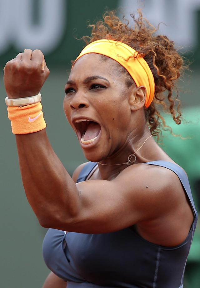 FILE - In this June 8, 2013 file photo, Serena Williams, of the U.S, celebrates a winning point as she plays Russia's Maria Sharapova during the Women's final match of the French Open tennis tournament at the Roland Garros stadium in Paris. Williams is The Associated Press' 2013 Female Athlete of the Year, easily winning a vote by news organizations. (AP Photo/Michel Euler, File)