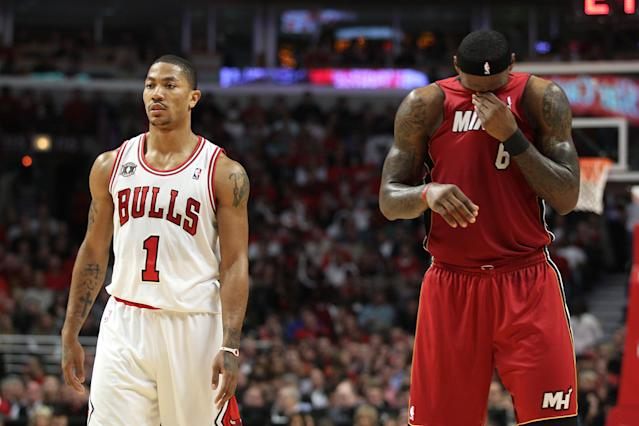 CHICAGO, IL - MAY 26: (L-R) Derrick Rose #1 of the Chicago Bulls looks on as LeBron James #6 of the Miami Heat wipes his face with his jersey in Game Five of the Eastern Conference Finals during the 2011 NBA Playoffs on May 26, 2011 at the United Center in Chicago, Illinois. NOTE TO USER: User expressly acknowledges and agrees that, by downloading and or using this photograph, User is consenting to the terms and conditions of the Getty Images License Agreement. (Photo by Mike Ehrmann/Getty Images)