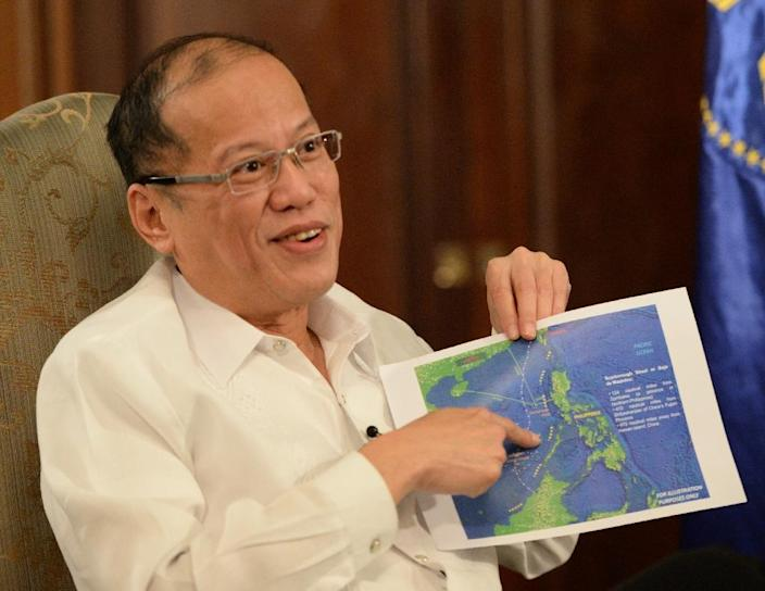 Philippine President Benigno Aquino has warned over China's activities in the South China Sea (AFP Photo/Ted Aljibe)