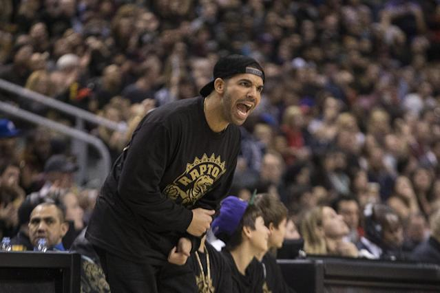 Rapper Drake yells his support for Toronto Raptors during their 96-80 win over Brooklyn Nets during the second half of an NBA basketball game, Saturday, Jan. 11, 2014 in Toronto (AP Photo/The Canadian Press, Chris Young)