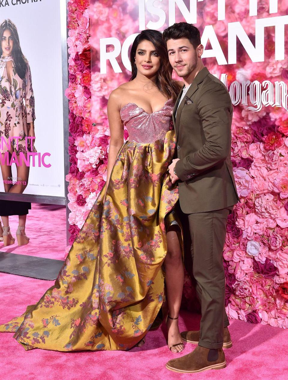 <p>Priyanka Chopra and Nick Jonas attend the premiere of Warner Bros. Pictures' 'Isn't It Romantic' at The Theatre at Ace Hotel on February 11, 2019 in Los Angeles, California. </p>