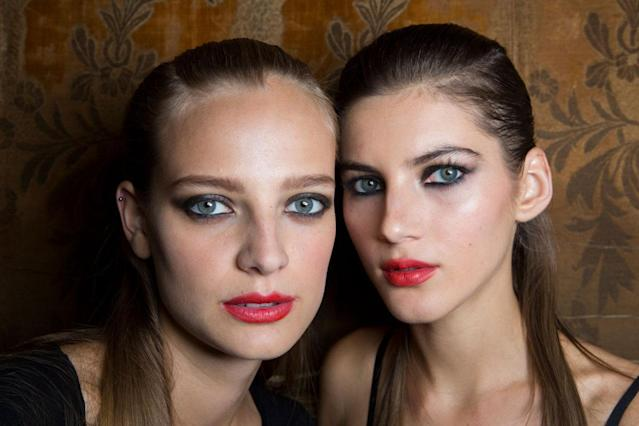 <p>It's always been a rule not to wear dark makeup on the eyes and lips simultaneously, but at Carolina Herrera, these models proved that a red lip can be understated. (Photo: ImaxTree) </p>