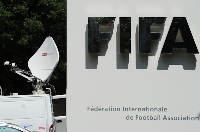A television broadcast van stands next to a FIFA sign prior to a press conference following the extraordinary meeting of the FIFA Executive Committee, at the FIFA headquarters in Zurich, Switzerland, Tuesday, July 17, 2012. FIFA ruling board members meet on Tuesday to appoint a corruption prosecutor who will be urged to investigate how hosting rights for the 2018 and 2022 World Cups were awarded. As part of FIFA President Sepp Blatter's anti-corruption reforms, his executive committee in Zurich will choose lawyers to lead independent prosecuting and judging chambers of a revamped ethics court. FIFA's top anti-corruption adviser, Mark Pieth, told The Associated Press the scheduled appointments are key to modernizing football's scandal-hit world governing body. (AP Photo/Keystone/Steffen Schmidt)