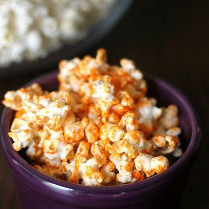 """<div class=""""caption-credit""""> Photo by: Domestic Superhero</div><div class=""""caption-title"""">Sriracha Popcorn</div>Three ingredients is all it takes for this delicious and spicy topping! <br> <a href=""""http://domesticsuperhero.com/2013/03/08/sriracha-popcorn-the-perfect-staying-at-home-and-watching-a-movie-snack/"""" rel=""""nofollow noopener"""" target=""""_blank"""" data-ylk=""""slk:Get the recipe"""" class=""""link rapid-noclick-resp""""><i>Get the recipe</i></a> <br> <b>More on Spoonful</b> <br> <a href=""""http://spoonful.com/recipes/fun-party-foods?cmp=ELP