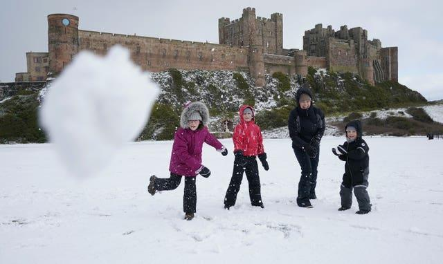A family have a snowball fight
