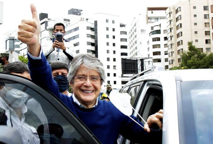 FILE PHOTO: Ecuador's presidential candidate Guillermo Lasso waves to supporters in Quito