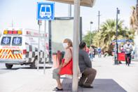 Women wait for public transportation outside Ciudad Juarez's General Hospital on April 27, 2021. The city has seen a spike in COVID-19 infections requiring the city to partially close businesses during the weekends.