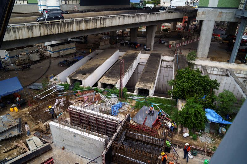 A construction site and a bridge are seen in the place of the Constitution Defense Monument in Bangkok