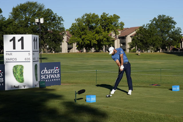 Dustin Johnson tees off at the 11th hole during the first round of the Charles Schwab Challenge golf tournament at the Colonial Country Club in Fort Worth, Texas, Thursday, June 11, 2020. (AP Photo/David J. Phillip)