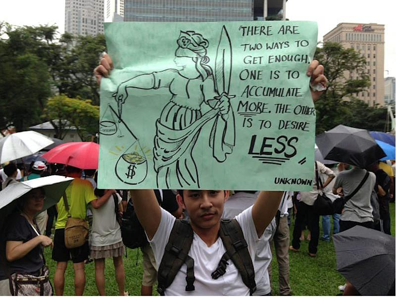 A protester holds up a placard during the Population White Paper protest last year. (Yahoo file photo)