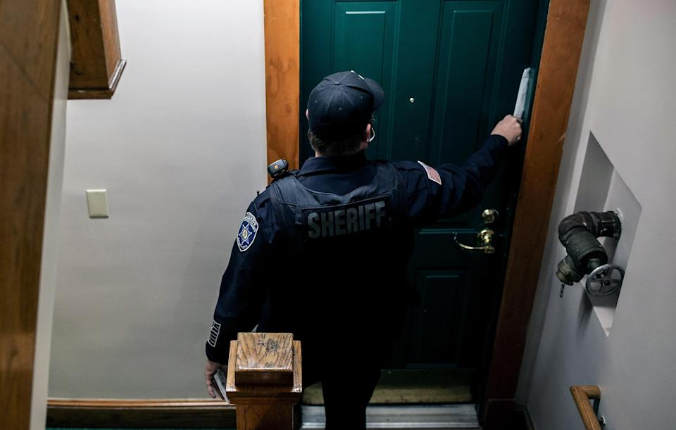 An eviction notice is placed in the doorway of an apartment in Springfield, Mass., on Dec. 16, 2020. (Bryan Anselm/The New York Times)