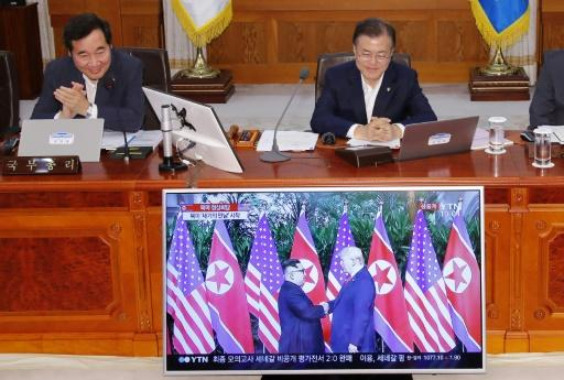 """South Korean President Moon Jae-in, right, said he spent a """"sleepless night"""" in excitement ahead of the summit"""