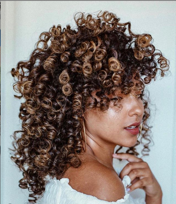 <p>Hair color connoisseurs who love their natural curl know that all you need to accentuate your texture is a pop of color, like the bursts of blonde pictured here.</p>