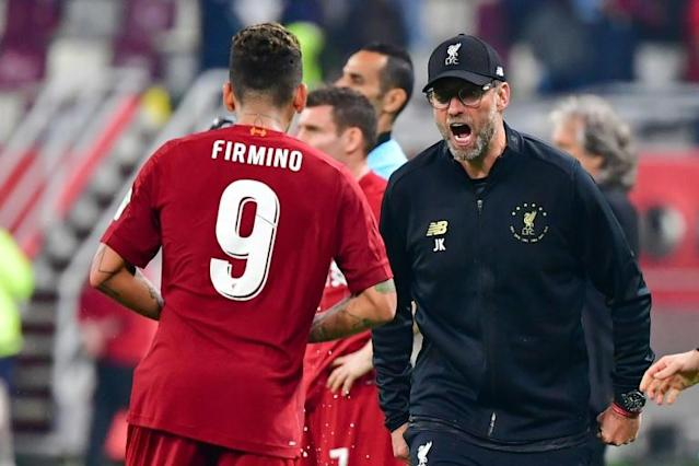 Roberto Firmino celebrates his goal with Jurgen Klopp (AFP Photo/Giuseppe CACACE)