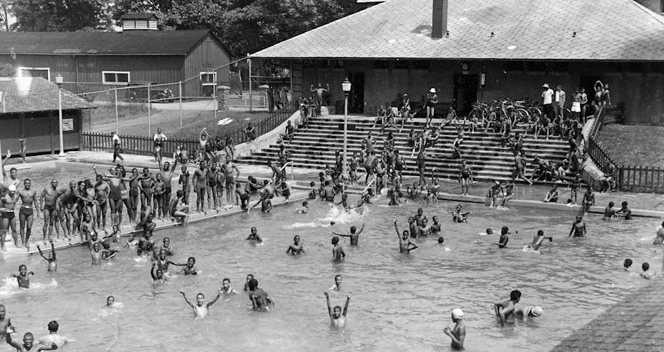 African American children in a segregated swimming pool at Druid Hill Park, Baltimore, Maryland, on July 4, 1940. (Afro American Newspapers/Gado/Getty Images)