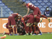Roma's Gianluca Mancini is celebrated by teammates after he scored his side's second goal during a Serie A soccer match between Roma and Inter Milan at Rome's Olympic stadium, Sunday, Jan. 10, 2021. (AP Photo/Gregorio Borgia)