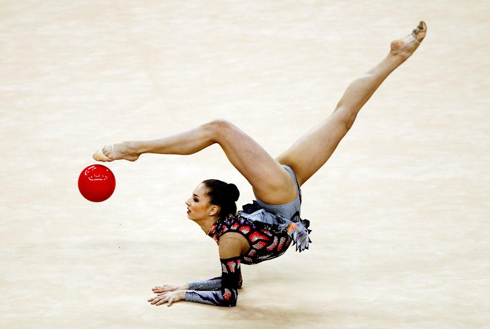 Alexandra Piscupescu of Romania in action in the Individual All-Around during the FIG Rhythmic Gymnastics Olympic Qualification round at North Greenwich Arena on January 18, 2012 in London.