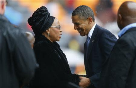 U.S. President Obama pays his respect to Graca Machel at the memorial service for Nelson Mandela in Johannesburg