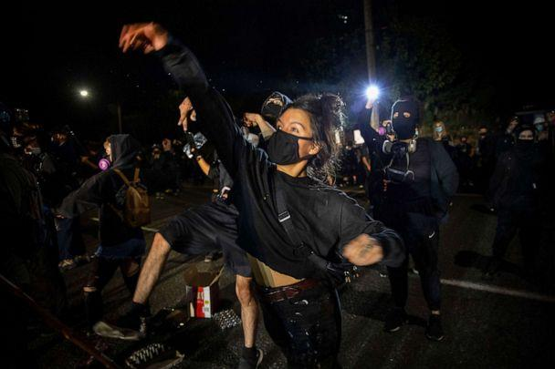 PHOTO: Protesters throw eggs at police during the nightly protests at a Portland police precinct on Aug. 30, 2020 in Portland, Ore. (Paula Bronstein/AP)