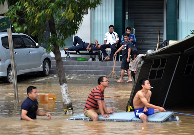 A new report says human-influenced climate change likely means more extreme weather events like the floods that hit Jakarta, Indonesia, where this business district was inundated in January 2014 (AFP Photo/Bay Ismoyo)