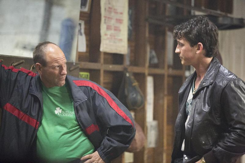 """In this image released by Open Road Films, Miles Teller, right, and Aaron Eckhart appear in a scene from the film, """"Bleed For This."""" (Seacia Pavao/Open Road Films via AP)"""