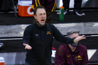 Minnesota head coach Richard Pitino questions a call in the second half of an NCAA college basketball game against Ohio State at the Big Ten Conference tournament in Indianapolis, Thursday, March 11, 2021. Ohio State defeated Minnesota 79-75. (AP Photo/Michael Conroy)