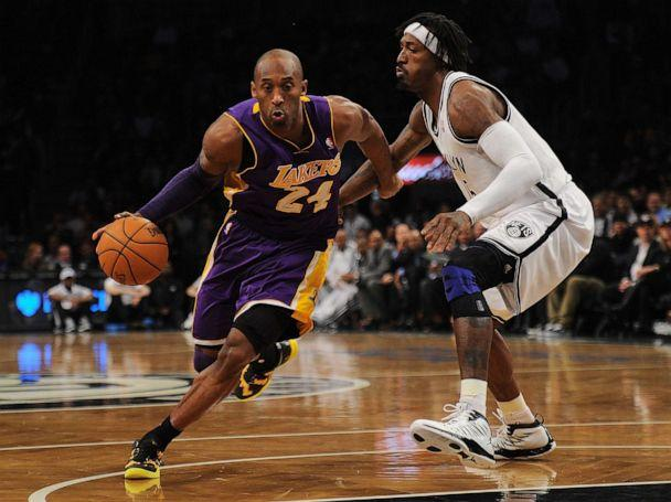 PHOTO: In this file photo taken on Feb. 5, 2013, Los Angeles Lakers' Kobe Bryant drives the ball past Brooklyn Nets Gerald Wallace during their NBA game at the Barclays Center in the Brooklyn borough of New York City. (Emmanuel Dunand/AFP via Getty Images, File)