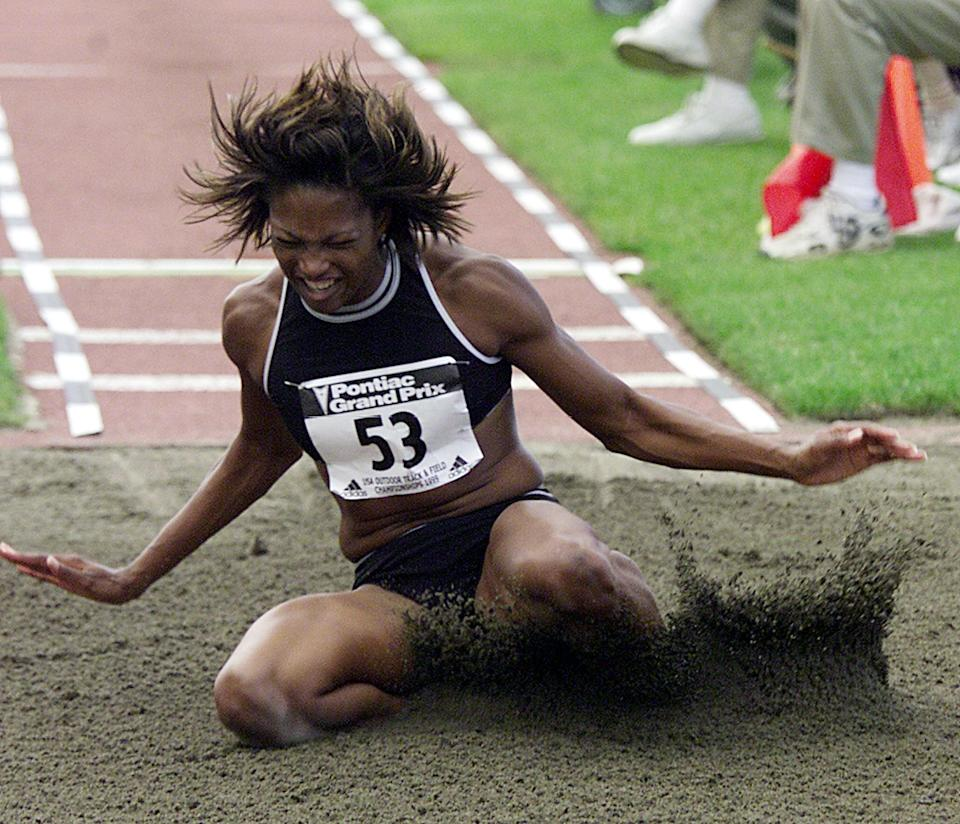 Dawn Burrell lands in the pit during one of her jumps at the Women's Long Jump at the US Outdoor Track & Field Championships at Hayward Field in 1999.