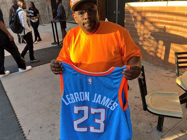 Darrell Bailey holds up his LeBron James Clippers jersey. (Alec Lewis)