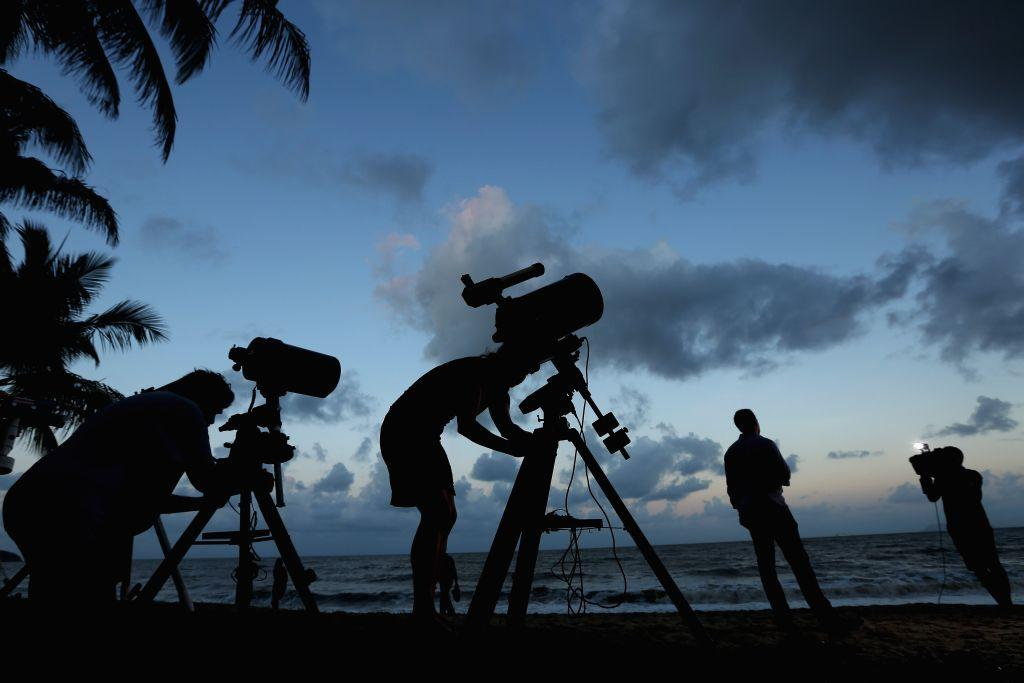 Telescopic cameras and computer equipment are set up on Palm Cove beach in preparation to run a live stream via NASA of the total solar eclipse on November 13, 2012 in Cairns, Australia.