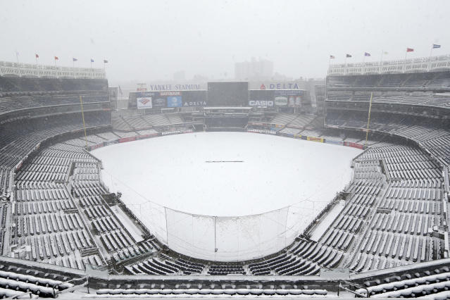 An early April snowstorm in New York put a damper on the Yankees' plans for the home opener.  (AP Photo)
