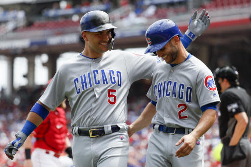 Chicago Cubs' Tommy La Stella (2) celebrates scoring on an RBI-sacrifice fly by Albert Almora Jr. (5) in the seventh inning of a baseball game against the Cincinnati Reds, Sunday, May 20, 2018, in Cincinnati. (AP Photo/John Minchillo)