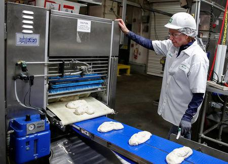 An employee checks on a dough during the production process at the Gonnella Baking Company in Aurora, Illinois, U.S., November 16, 2017. Picture taken November 16, 2017. REUTERS/Kamil Krzaczynski