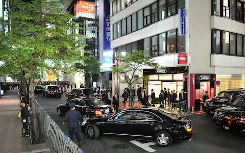 <span>Barack Obama arrived in a motorcade when he dined at Sukiyabashi Jiro </span> <span>Credit: KAZUHIRO NOGI/AFP via Getty Images </span>