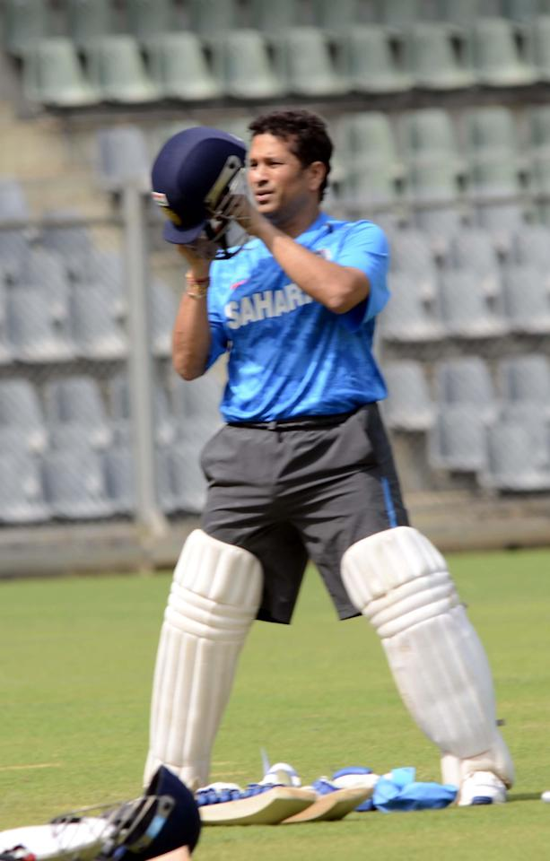 Sachin Tendulkar practice with Mumbai team at Wankhede stadium ahead of his last Ranji Trophy match for Mumbai against Haryana in Lahli, Rohtak, in Mumbai on Oct.24, 2013. (Photo: Sandeep Mahankaal/IANS)