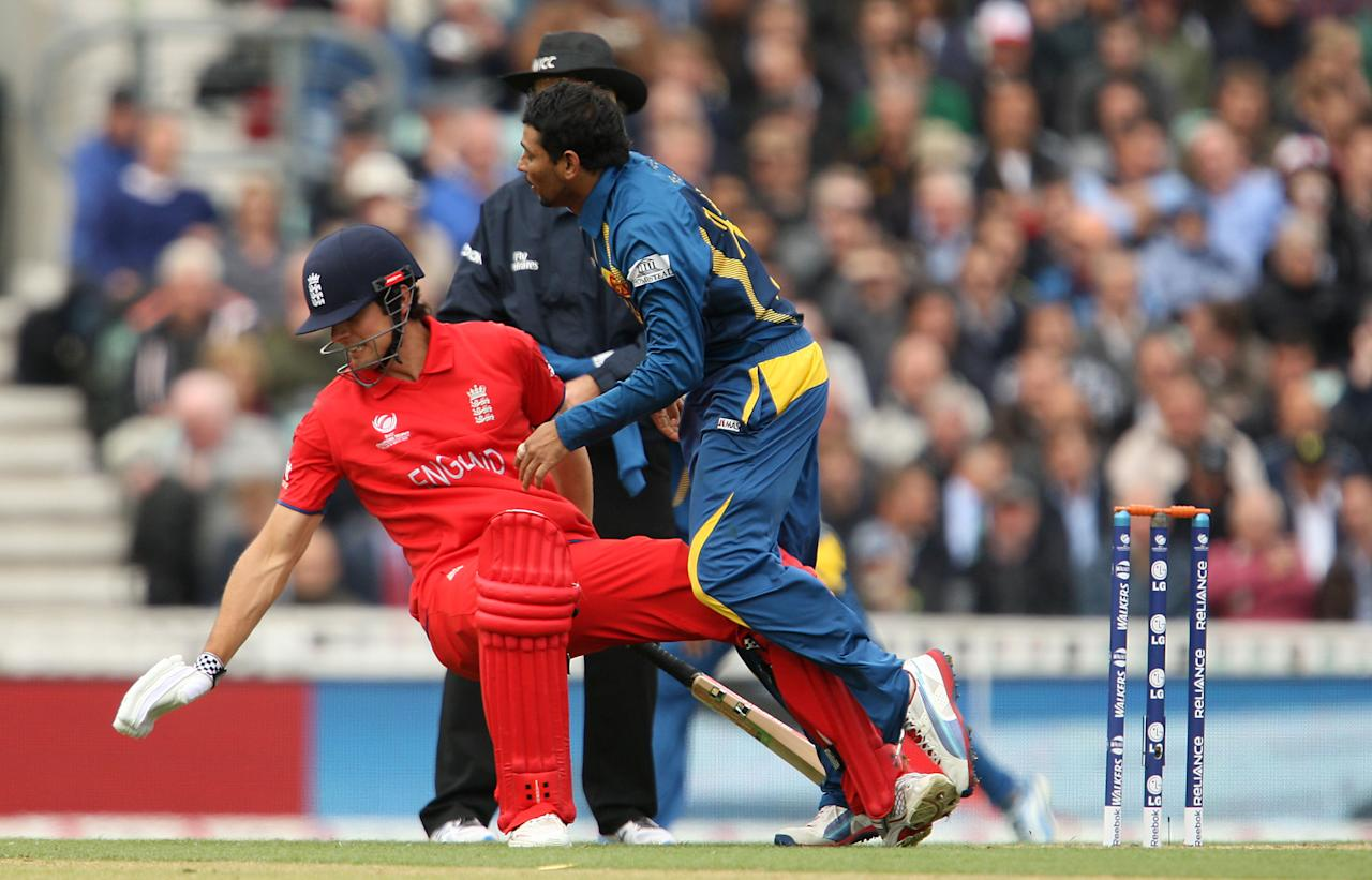 England's Alastair Cook and Sri Lanka's Tillakaratne Dilshan collide during the ICC Champions Trophy match at The Kia Oval, London.